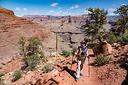 Hike the Hermit Trail from Hermits Rest to Lookout Point. Grand Canyon National Park, Arizona, USA. Starting at least 5 to 17 million years ago, erosion by the Colorado River has exposed a column of distinctive rock layers, which date back nearly two billion years at the base of Grand Canyon. While the Colorado Plateau was uplifted by tectonic forces, the Colorado River and tributaries carved Grand Canyon over a mile deep (6000 feet), 277 miles  long and up to 18 miles wide. Please inquire about licensing options for this image.
