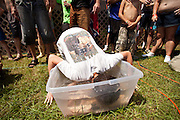 Participant in the pigs feet dunking contest during the annual Summer Redneck Games Dublin, GA.