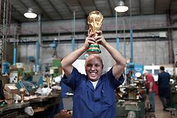 22.02.2014, Bertoni GDE, Mailand, ITA, FIFA WM, FIFA WM POKAL, Gazzaniga, im Bild Ein Mitarbeiter der Firma mit einem Replikat der WM-Trophae // during a Photoshooting of Silvio Gazzaniga, who is designed the FIFA Worldcup Trophy in the Year 1971 at the Bertoni GDE in Mailand, Italy on 2014/02/22. EXPA Pictures © 2014, PhotoCredit: EXPA/ Eibner-Pressefoto/ Cezaro<br /> <br /> *****ATTENTION - OUT of GER*****