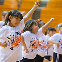 071813       Brian Leddy<br /> Natalia Amaya practices a routine during the Gallup Bengal Cheer Camp Thursday morning. The camp last from Monday to Thursday and saw about 100 kids participate.