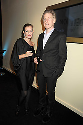 Designer TRACEY BOYD and her husband       at the opening of the Atelier Moet pop-up boutique, 70 New Bond Street, London on 3rd December 2008.