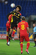 Belgium's Marouane Fellaini (8) wins a header from Simon Church. World cup 2014 qualifying match, Group A, Wales v Belgium at the Cardiff city stadium in Cardiff, South Wales on Friday 7th Sept 2012.  pic by  Andrew Orchard, Andrew Orchard sports photography,