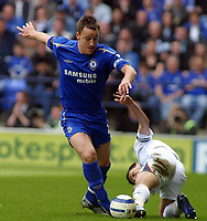 Photo: Paul Thomas.<br /> Bolton Wanderers v Chelsea. The Barclays Premiership. 15/04/2006.<br /> <br /> Bolton's Jared Borgetti (R) is tackled by Chelsea's John Terry.