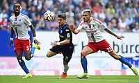 Fotball, 30 August 2014,<br /> Fussball Bundesliga, Hamburger SV - SC Paderborn 07 0:3<br /> v.l. Johan Djourou, Moritz Stoppelkamp (Paderborn), Valon Behrami<br /> <br /> Norway only