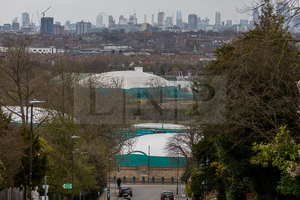 © Licensed to London News Pictures. 31/03/2020. London, UK. Views of the All England Lawn Tennis Club, Wimbledon with its covered grass courts. AELTC which is set to announce on Wednesday (1 April) the cancellation of the Wimbledon Tennis Championships 2020 due to the coronavirus pandemic. The pandemic has led to the cancellation of major sporting events across the World as the coronavirus crisis continues. Photo credit: Alex Lentati/LNP