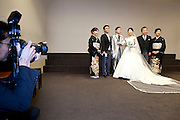 family standing for the traditional parents with bride and groom group photo Japan