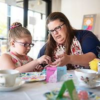Mother and daughter Stacey Hunkus and Olivia Hunkus, 6 decorate a lip balm container at a Mother's Day Craft-Tea event at Art123, Saturday May 4, in Gallup.