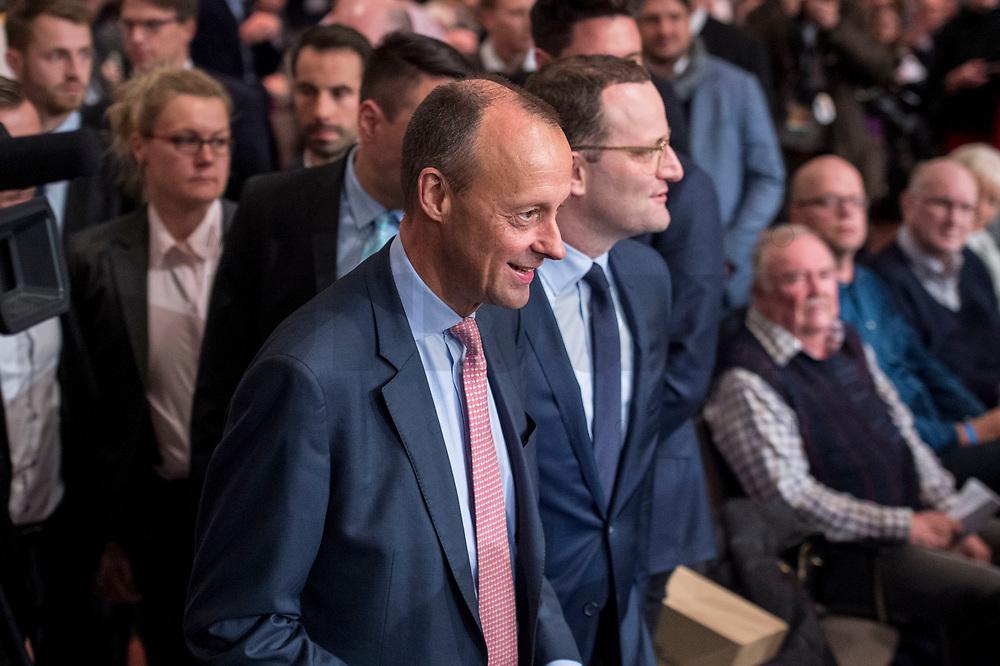 30 NOV 2018, BERLIN/GERMANY:<br /> Friedrich Merz (L), CDU, Rechtanwalt und ehem. stellv. CDU/CSU Fraktionsvorsitzender, und Jens Spahn (R), CDU, Bundesgesundheitsminister, auf dem Weg zum Podium, waehrend der Regionalkonferenz der CDU zur Vorstellung der Kandidaten fuer das Amt des Bundesvorsitzenden der CDU, Estrell Convention Center<br /> IMAGE: 20181130-01-001