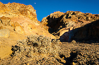 United States, California, Death Valley. Artist's Drive at the foot of the Black Mountains. The Moon above the mountain.