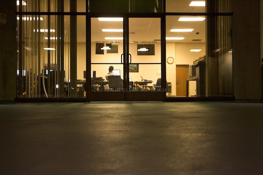 Stanford after dark. Stanford senior, Jeff Allen studies in the Computer Lair
