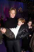 Jeremy Sumpter carrying Freddie Popplewell, party after the Peter Pan film world premiere in aid of the Great Ormond St. Embankment park. 9 December 2003. hospital.© Copyright Photograph by Dafydd Jones 66 Stockwell Park Rd. London SW9 0DA Tel 020 7733 0108 www.dafjones.com