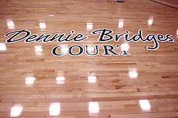 21 February 2015:  Dennie Bridges name is added to the floor of the basketball court in Shirk Center.  At half time of an NCAA D# CCIW men's basketball game between the Illinois Wesleyan Titans in Shirk Center, Bloomington IL the floor was named in honor of retiring Dennie Bridges.  Dennie Bridges has been on the job at IWU for 51 years as a basketball coach, then athletic director.  Dennie is the 2nd winningest D3 coach by wins behind only Dick Saurs.  Dennie took the Titans to the D3 NCAA tournament 14 times in 18 season. He had a league record of 421-129 in 17 seasons.  Jack Sikma was a part of Dennie's 1973 recruiting class.  Sikma later played for the Milwaukee Bucks and Seattle Supersonics in the NBA.  IWU President Richard Wilson presided over the ceremony.
