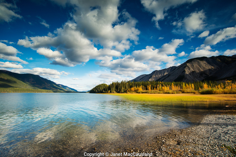 This is a perfect example of a beautiful photograph which  was taken in broad daylight, not at magic hour or the golden hours of morning or evening. While it is true that low, warm light makes things look better, some places are so beautiful, as is much of the Yukon, that it doesn't need magic.