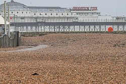 © Licensed to London News Pictures. 22/02/2020. Brighton, UK. A empty beach infant of the Brighton Palace Pier as cold weather and strong winds hot the Brighton and Hove seafront. Photo credit: Hugo Michiels/LNP