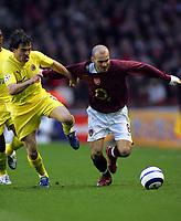 Fredrik Ljungberg is challenged by Villareal's<br />Arsenal V Villarreal 19/04/06 at Highbury<br />The UEFA Champions League Semi Final 1st Leg<br />Photo Robin Parker Fotosports International