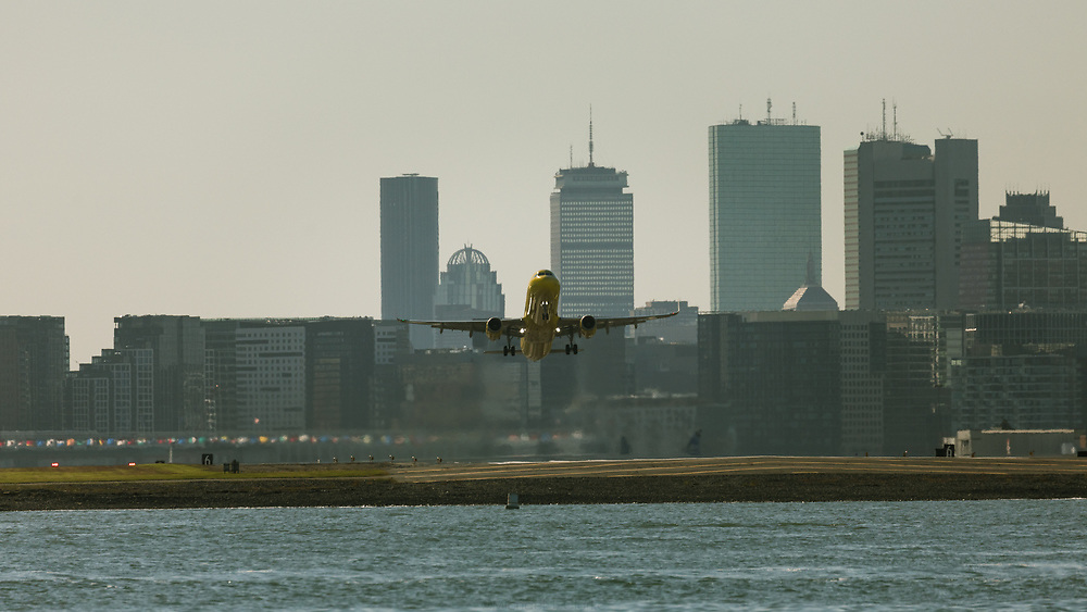A Spirit Airlines jetliner lifting off from Logan.