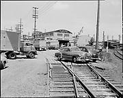"Ackroyd 05212-2. ""Glens Falls Insurance. Spray painting damage to cars at Albina Engine & Machine. May 19, 1954"""
