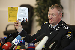 May 22, 2018 - Kiev, Ukraine - National Police of Ukraine head chief Serhiy Knyazev presents a booklet for foreign guests of Champions League Final during the press conference in Kyiv, Ukraine, May 22, 2018. Ukrainian police in cooperation with Specialized Anti-Corruption Prosecutor's Office (SAPO) investigate the case on match-fixing by referees, FC's presidents and top management of National Football Federation. (Credit Image: © Sergii Kharchenko/NurPhoto via ZUMA Press)