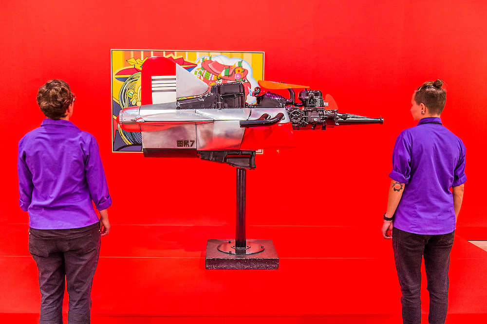 Machine No 7 by Shinkichi Tajiri (in front of Big Tears for Two 1963 by Erro) - The EY Exhibition: The World Goes Pop, opens at the Tate Modern. The exhibition covers the full breadth of international Pop Art from the 1960s and 70s, 'exploding' the traditional story of Pop. The show features 'colourful and exciting' works from Latin America, Asia, Europe and the Middle East – the majority of which have never before been shown in the UK. Highlights include: Japanese pop artist Tajiri's striking large scale sculpture Machine No.7, surrounded by works by artists Ushio Shinohara, Erro, Equipo Cronica and Evelyne Axel; a mirrored full room installation specially recreated for this exhibition by Polish pop artist Jana Zelibska; and Henri Cueco's multi-layered sculptural work Large Protest 1969 seen in front of his painting The Red Men, bas-relief 1969, exploring the Cold War, Vietnam War and May 1968 protests in Paris. The Exhibition is at Tate Modern from 7 September 2015 - 24 January 2015.