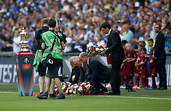 FA President Prince William, the Duke of Cambridge, lays down a wreath in honour of the victims of the Manchester Terrorist attacks during the Emirates FA Cup Final at Wembley Stadium, London.