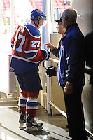 KELOWNA, CANADA, FEBRUARY 15: Curtis Lazar #27 of the Edmonton OIl Kings exits the ice after warm up and speaks with a fan at the Kelowna Rockets on February 15, 2012 at Prospera Place in Kelowna, British Columbia, Canada (Photo by Marissa Baecker/Shoot the Breeze) *** Local Caption ***