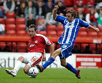 Photo: Ed Godden.<br />Bristol City v Brighton & Hove Albion. Coca Cola League 1. 02/09/2006. Richard Keogh (L), clears the ball from Brighton's Doug Loft.