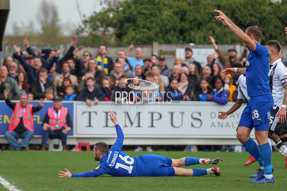 AFC Wimbledon midfielder Dylan Connolly (16) going down in the box and appealing for a penalty during the EFL Sky Bet League 1 match between AFC Wimbledon and Gillingham at the Cherry Red Records Stadium, Kingston, England on 23 March 2019.