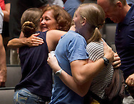 West Point, New York - Cadet candidates get hugs from their families during the 90 seconds they have to say goodbye at Eisenhower Hall on Reception Day at the United States Military Academy at West Point on July 2, 2014. About 1,200 cadet candidates, the West Point Class of 2018, reported to the academy to begin their military careers.
