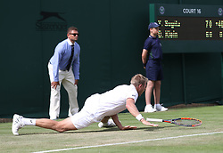 Brydan Klein slips over in his game against Yuichi Sugita on day two of the Wimbledon Championships at the All England Lawn Tennis and Croquet Club, Wimbledon. PRESS ASSOCIATION Photo. Picture date: Tuesday July 4, 2017. See PA story TENNIS Wimbledon. Photo credit should read: Philip Toscano/PA Wire. RESTRICTIONS: Editorial use only. No commercial use without prior written consent of the AELTC. Still image use only - no moving images to emulate broadcast. No superimposing or removal of sponsor/ad logos.