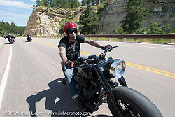 Buckcherry's drummer Xavier Muriel on the Annual Cycle Source and Michael Lichter Rides (combined this year) left from the new Broken Spoke area of the Iron Horse Saloon during the Sturgis Black Hills Motorcycle Rally. SD, USA.  Wednesday, August 10, 2016.  Photography ©2016 Michael Lichter.