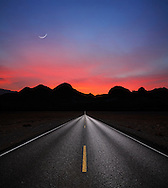Desert Highway And Mountains At Sunrise Near Lake Mead And The Nevada - Arizona Border, USA