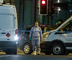 © Licensed to London News Pictures. 02/02/2020. London, UK. Forensic officers on Streatham High Road as police investigate a terror attack in Streatham, South London where police shot dead a knife-wielding suspect in a suicide vest after two people were stabbed. Photo credit: Alex Lentati/LNP