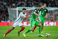 England (11) Oxlade-Chamberlain, Slovenia (6)Rene Krhin during the FIFA World Cup Qualifier match between England and Slovenia at Wembley Stadium, London, England on 5 October 2017. Photo by Sebastian Frej.