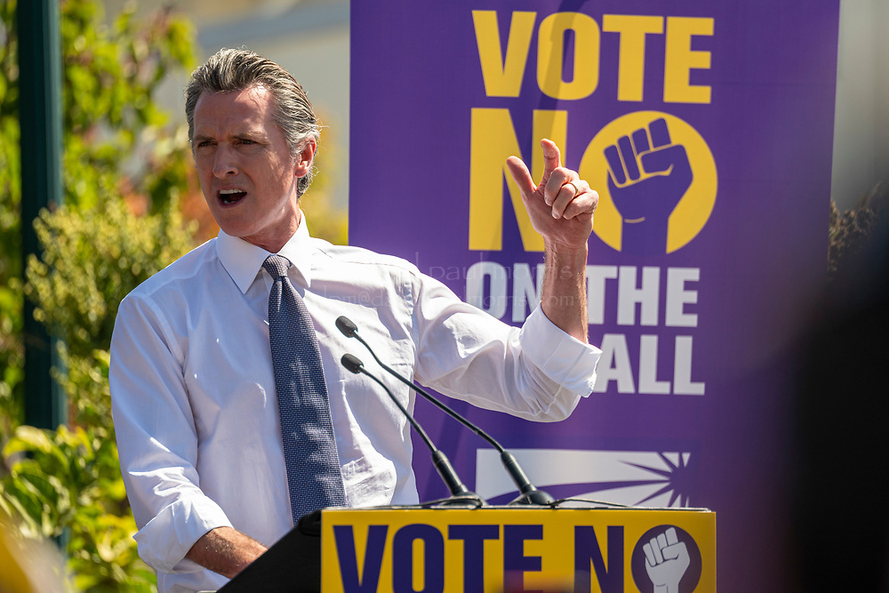 Gavin Newsom, governor of California speaks during an event in Oakland, California, U.S., on Saturday, September 11, 2021. Democratic allies of California Gov. Gavin Newsom continued to express confidence Saturday in his chances of beating back a recall but warned his supporters not to let up on urging people to vote as they seek a decisive win, while Republicans said the contest is far from settled.Photographer: David Paul Morris