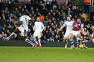 Rudy Gestede of Aston Villa ® shoots and scores his teams 1st goal to make it 1-1.  Barclays Premier league match, Aston Villa v Leicester city at Villa Park in Birmingham, The Midlands on Saturday 16th January 2016.<br /> pic by Andrew Orchard, Andrew Orchard sports photography.