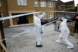 © London News Pictures. 21/05/2016. Weybridge, UK. Police forensics entering a property at St George's Hill, Weybridge, Surrey where the body of a woman in her 30's was discovered by paramedics this morning (Sat). Photo credit: Peter Macdiarmid/LNP