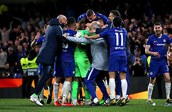 Chelsea players and members of staff celebrate winning the penalty shoot out during the UEFA Europa League, Semi Final, Second Leg at Stamford Bridge, London.