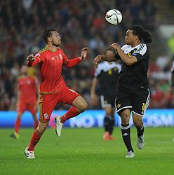 Aaron Ramsey of Wales (Arsenal) closes down Jason Denayer of Belgium (Celtic) - Photo mandatory by-line: Alex James/JMP - Mobile: 07966 386802 - 12/06/2015 - SPORT - Football - Cardiff - Cardiff City Stadium - Wales v Belgium - Euro 2016 qualifier