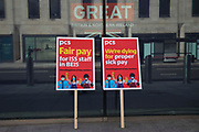 Placards used by members of the PCS trade union working for the outsourced contractor ISS on a picket line outside their workplace at the Department for Business, Energy and Industrial Strategy BEIS on the second day of a 3-day strike are pictured on 20th July 2021 in London, United Kingdom. The striking cleaners, security guards and other support staff at the government department are demanding an end to low pay, improved working conditions, bonuses for having worked through lockdown, annual leave from last year and a Covid return-to-work protocol.