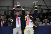 Henley, Great Britain.  Henley Royal Regatta. Winners of the Double Sculls Challenge Cup, Leander Club, Matthew WELLS, and Marcus BATEMAN, raise the Trophy, in celebration. River Thames,  Henley Reach.  Royal Regatta. River Thames Henley Reach. Sunday  16:57:10  03/07/2011  [Mandatory Credit/Intersport Images] . HRR