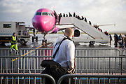 A man waits to board a Wizzair flight at Beauvais - Tillé Airport, near Paris, France.