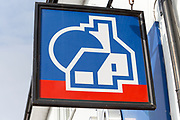 Wall mounted sign for Nationwide building society,  Amesbury, Wiltshire, England, UK