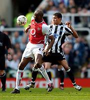 Fotball<br /> Photo. Jed Wee, Digitalsport<br /> NORWAY ONLY<br /> Newcastle United v Arsenal, FA Barclaycard Premiership, St James' Park, Newcastle. 11/04/2004.<br /> Arsenal's Patrick Viera (L) holds off Newcastle's Jermaine Jenas.