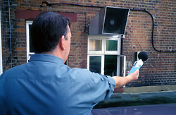 Council officer measuring noise level, Haringey, North London UK