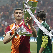 Galatasaray's Burak Yilmaz celebrate with the trophy after their Turkish Super League soccer match against Trabzonspor at Turk Telekom Arena stadium May 18, 2013.Galatasaray won the Turkish league title for the 19th time. Photo by TURKPIX