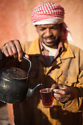 Sudanese Bedouin driver and cook Ahmed pours the photographer a cup of hot tea at the Bedouin Roads camp in Wadi Rum, Jordan.
