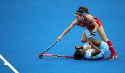 USA's Caitlin van Sickle clashes with India's Sunita Lakra