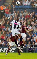 Photo: Leigh Quinnell.<br /> West Bromwich Albion v Arsenal. The Barclays Premiership.<br /> 15/10/2005. WBAs Nwankwo Kanu rises with Arsenals Cesc Fabregas.