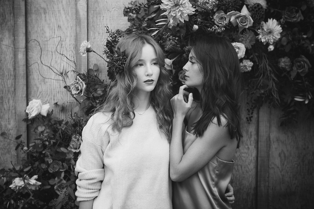POLLEN Series<br /> Hair by: Nicole Greer<br /> Flowers by: Flower Frenzy<br /> Models: <br /> Vivian and Janie<br /> ©justinalexanderbartels.com<br /> Two models in front of flower arrangement.