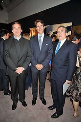 Left to right, ?, CROWN PRINCE PAVLOS OF GREECE and CHRISTOS ZAMPOUNIS at a party to celebrate the publication of Elena Makri Liberis's book 'Every Month, Same day' held at Sotheby's, 34-35 New Bond Street, London on 5th May 2009.